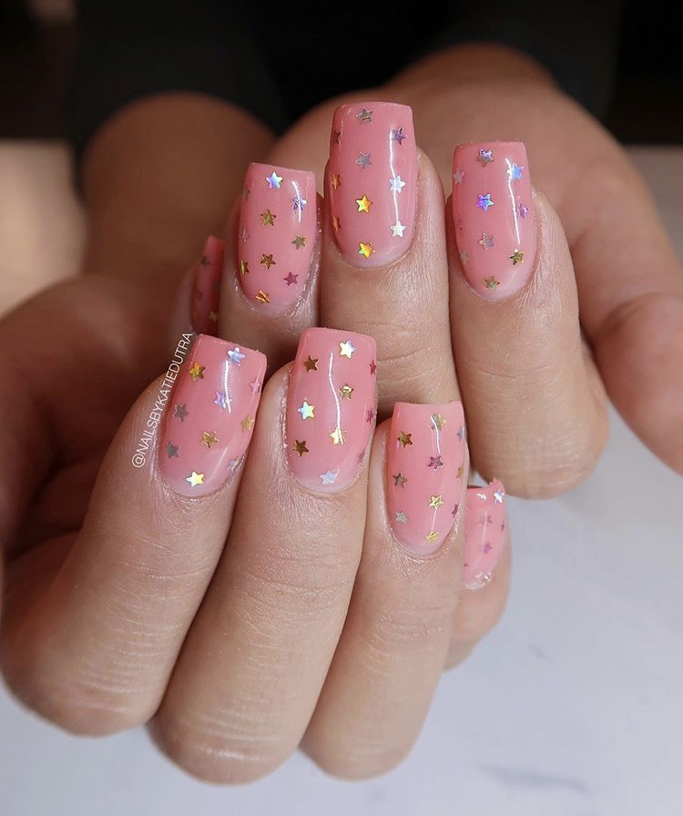 Tender pink and shiny star nails