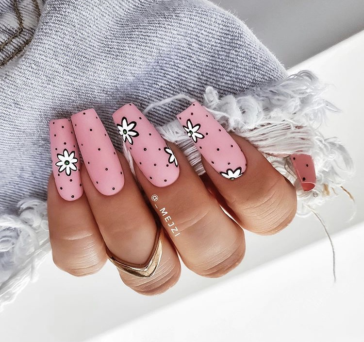 Matte pink flowers with long acrylic nails