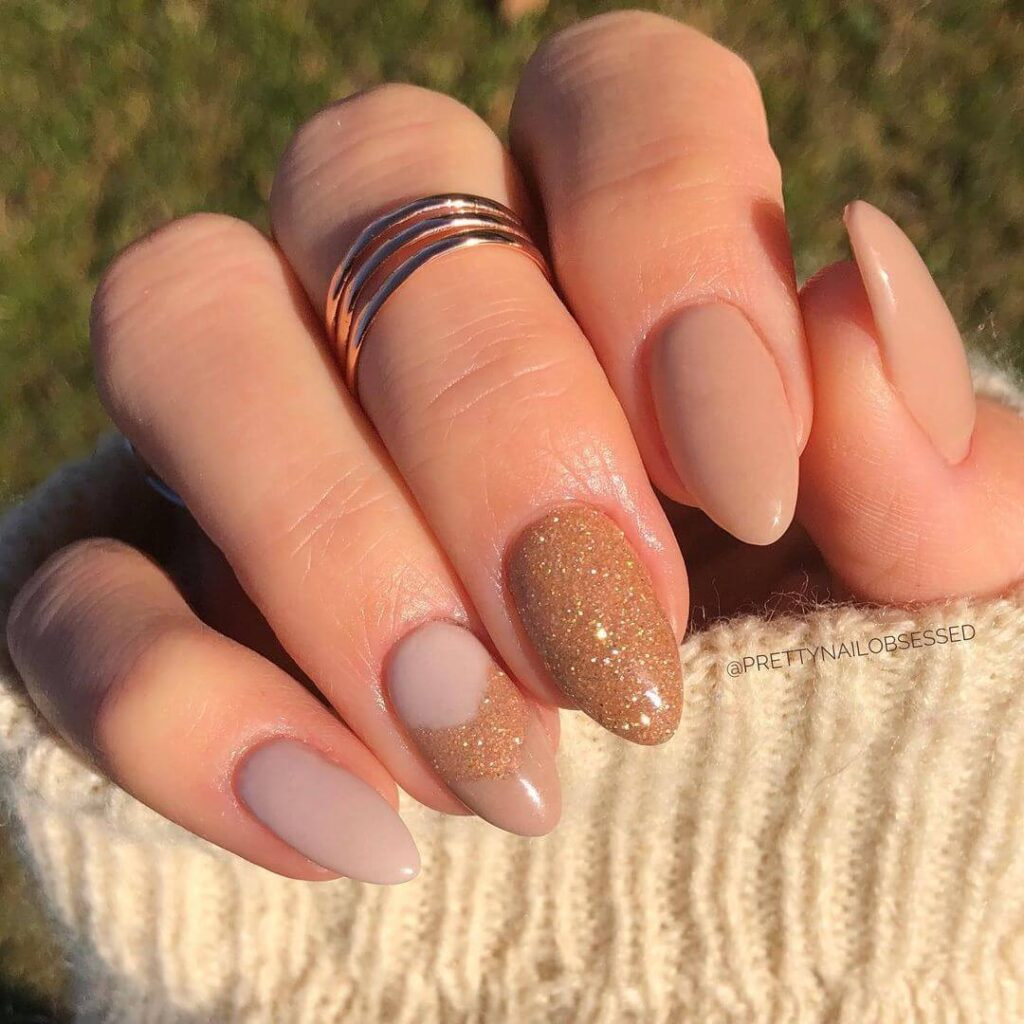 Gold nude almond nails