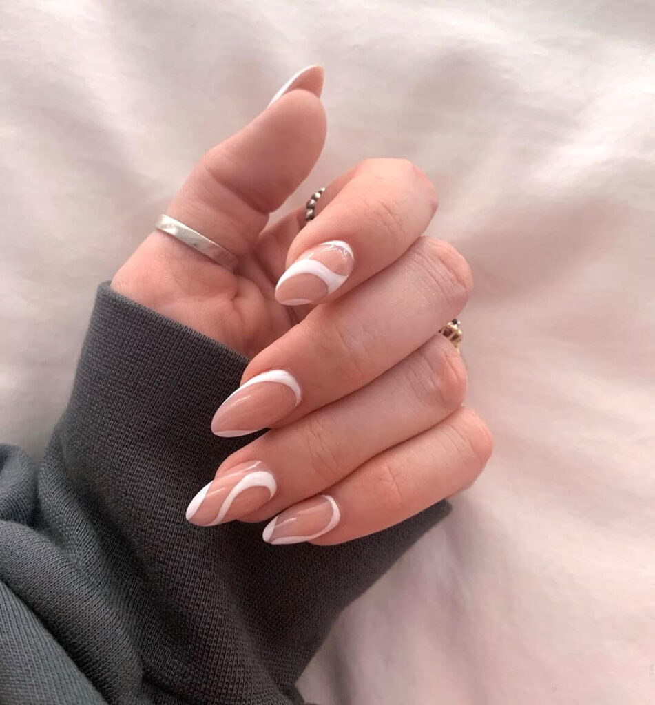 White swirled almond nails