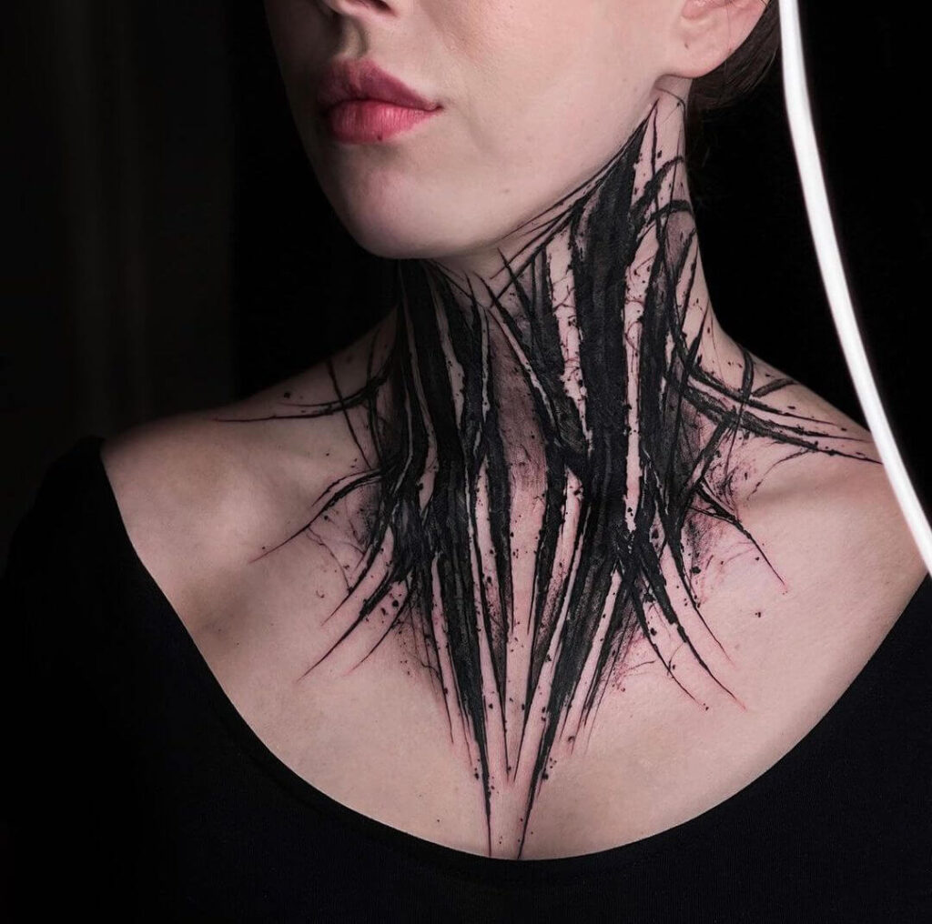 Abstract neck tattoo