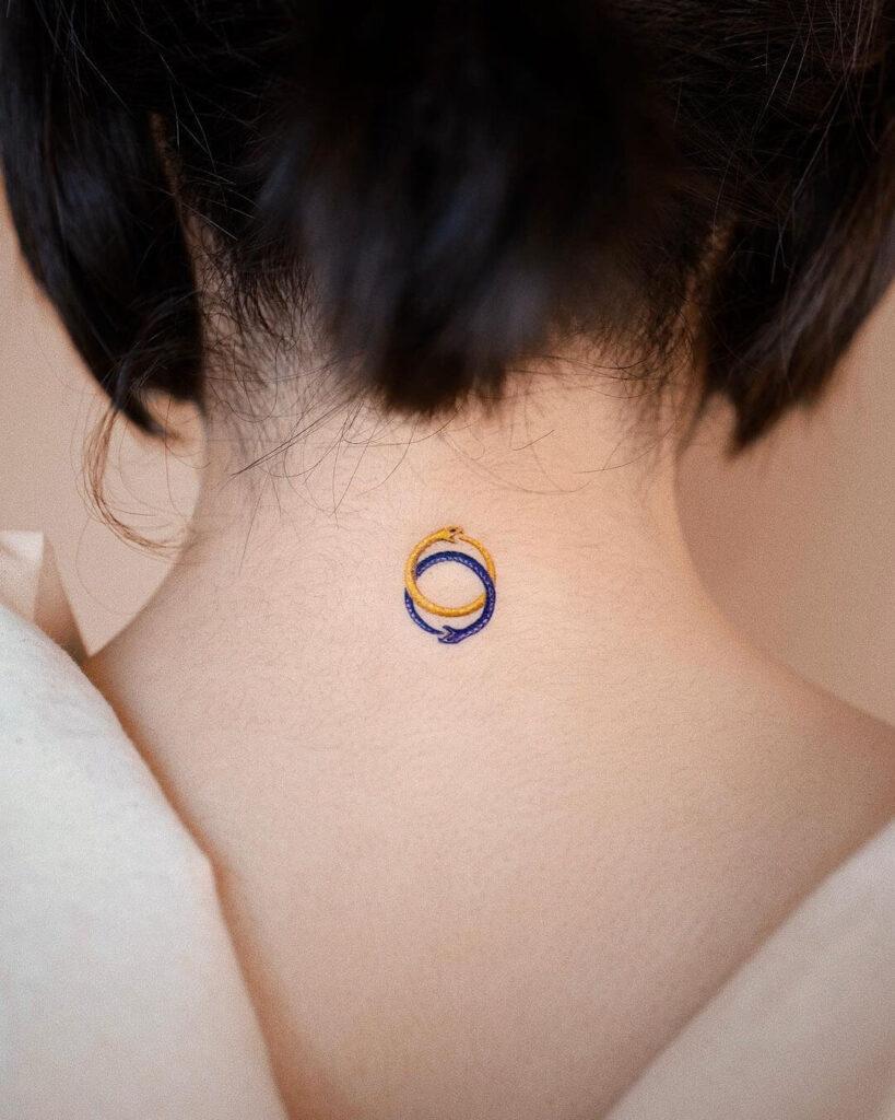 Mini neck tattoo