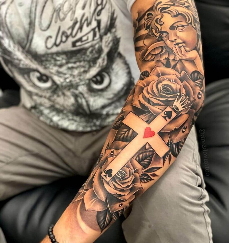 Cross sleeve tattoo