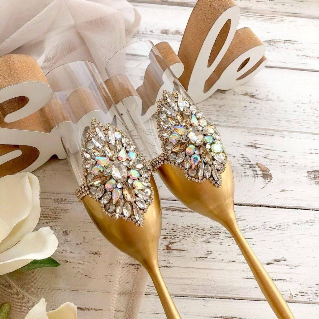 Golden ornate wedding glasses