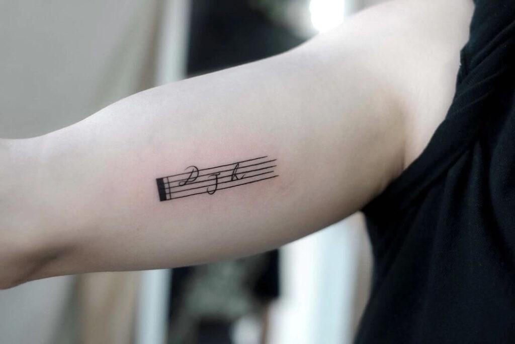 Music symbol family tattoo