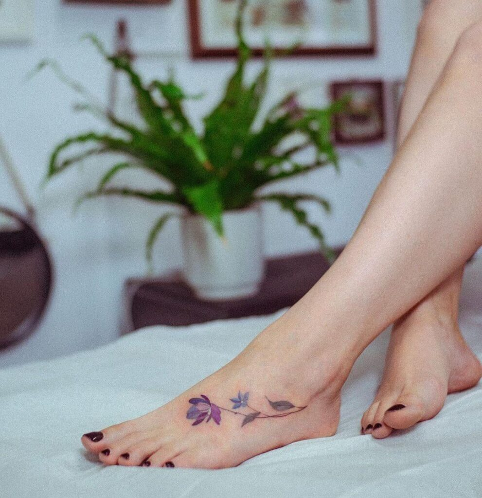 Color flowers Foot tattoo
