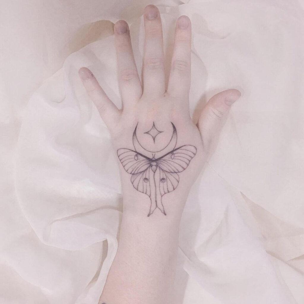 Moth moon tattoo
