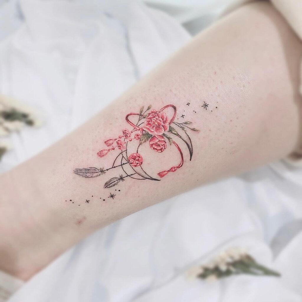 Oriental style moon tattoo