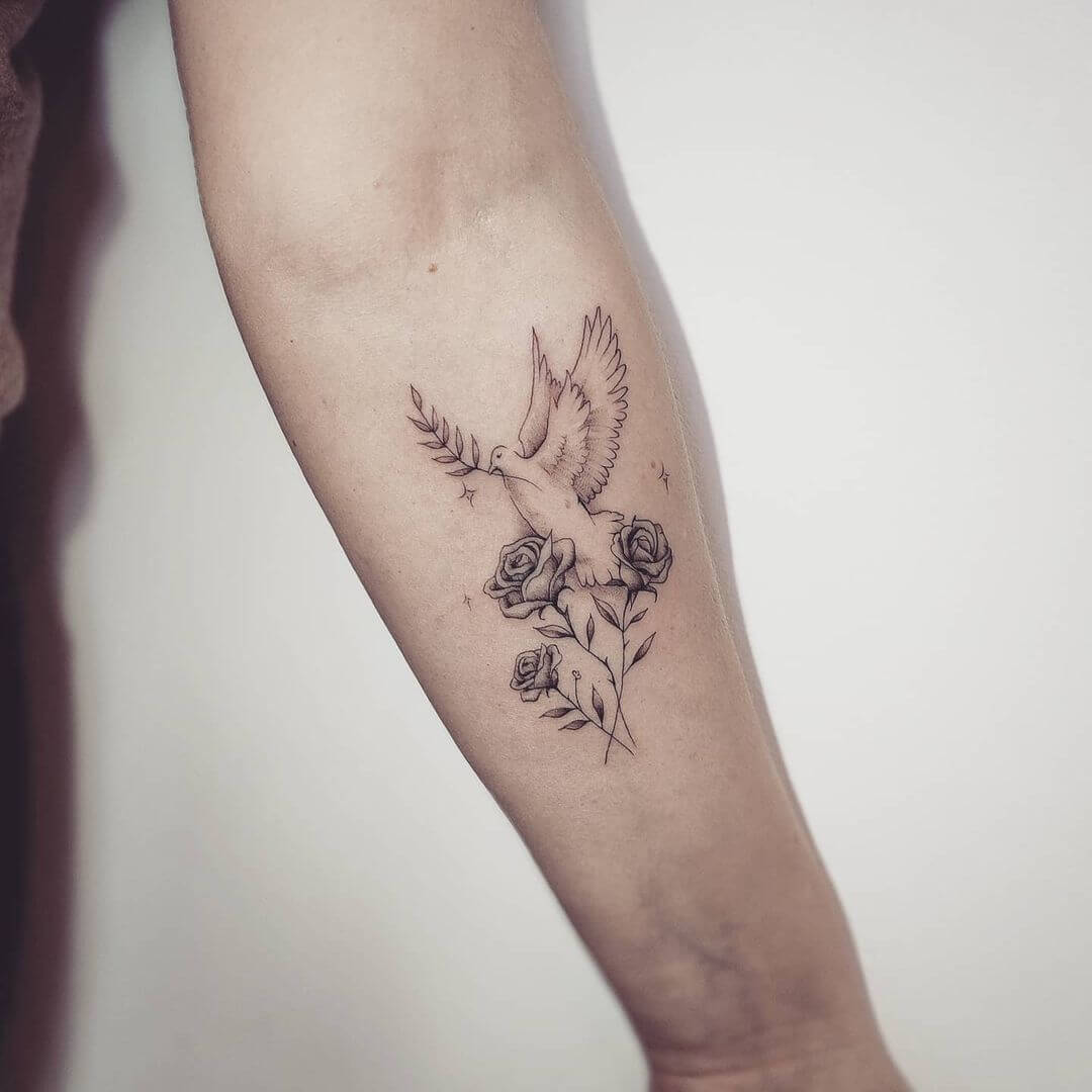 Bird and flower tattoo