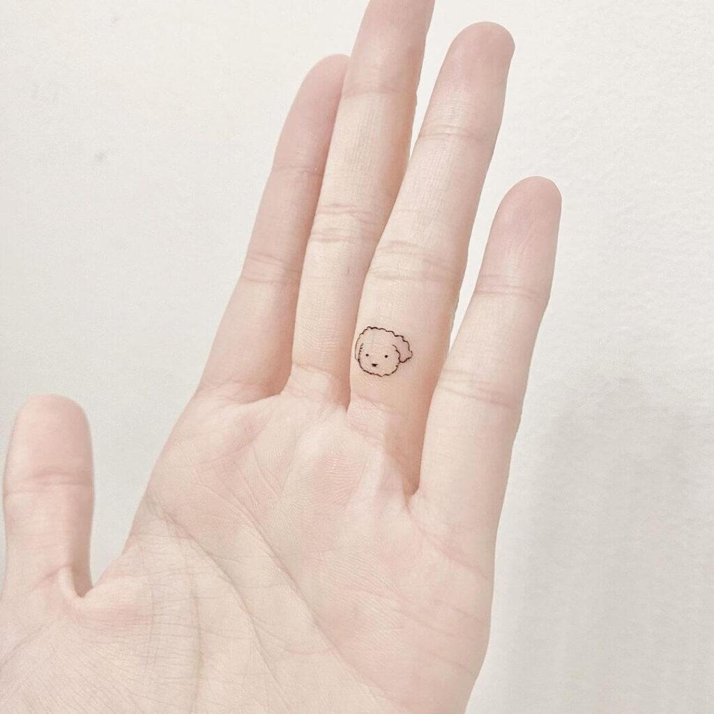 Dog finger tattoo