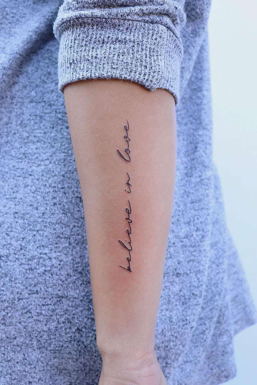 Vertical quote tattoo