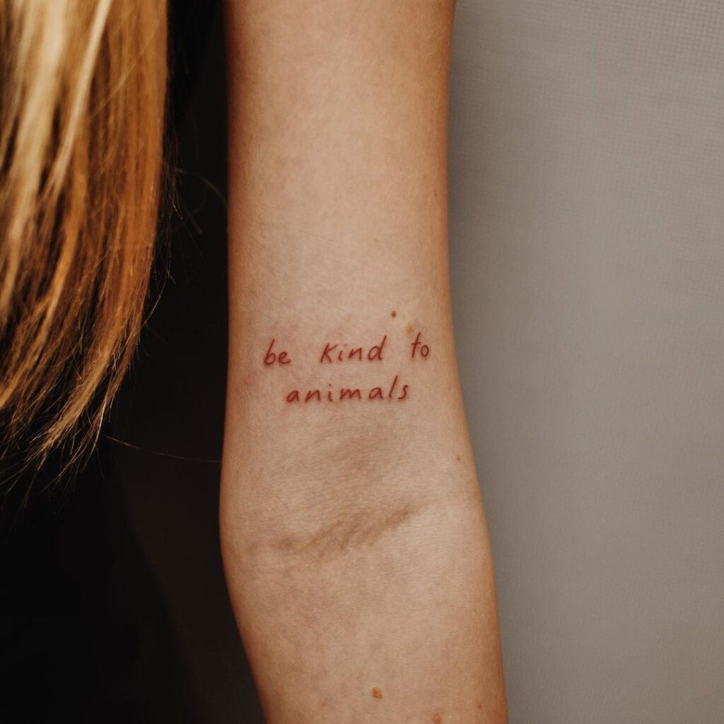 red quote tattoo