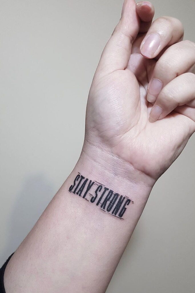 wrist quote tattoo