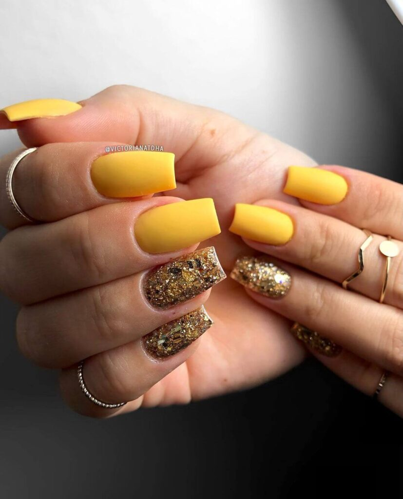 Yellow and gold square nails