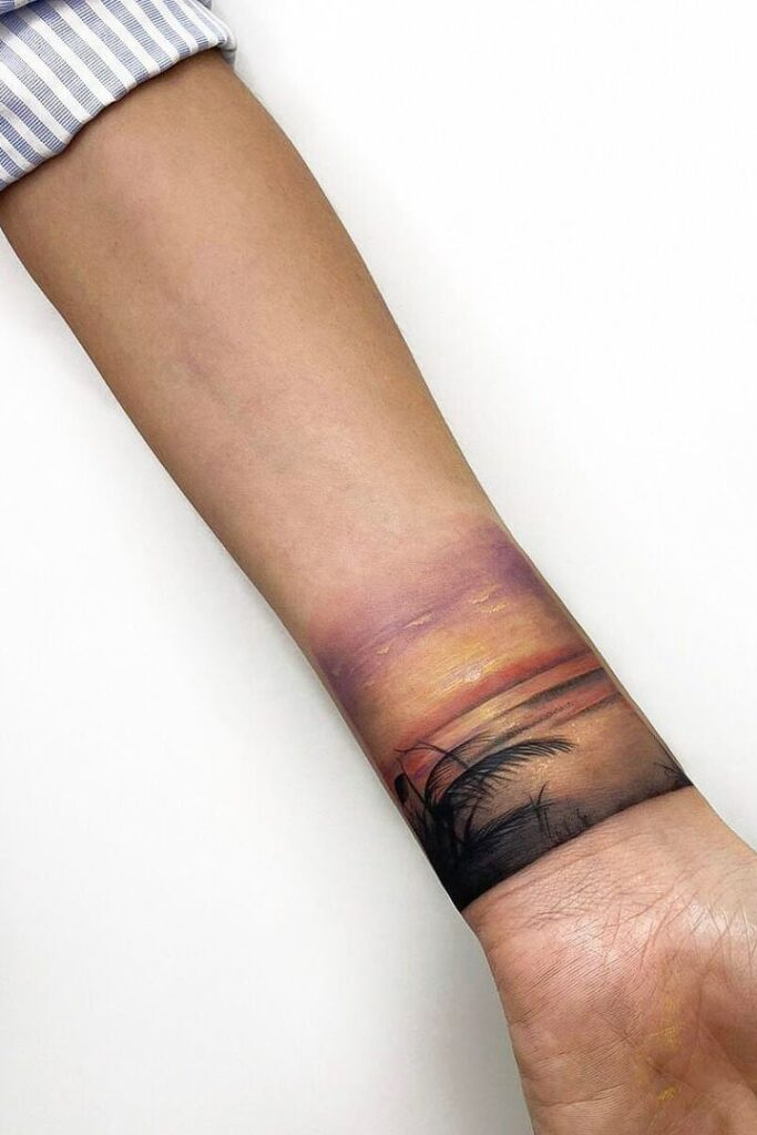 Beach sunset wrist tattoo