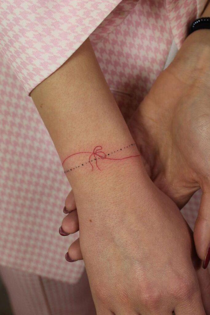 Bow Wrist Tattoo