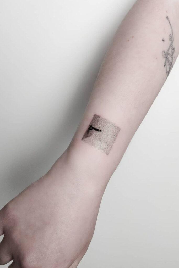 Abstract wrist tattoo