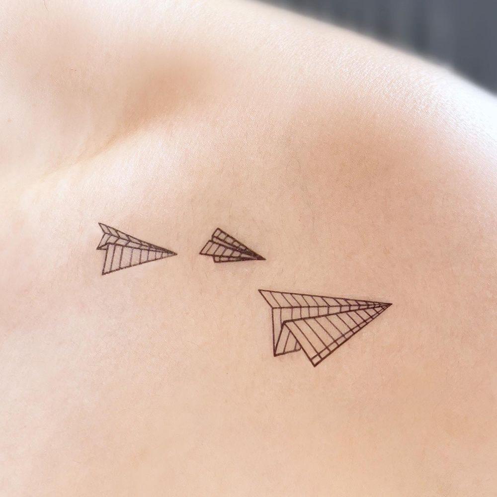 Paper airplane line tattoo