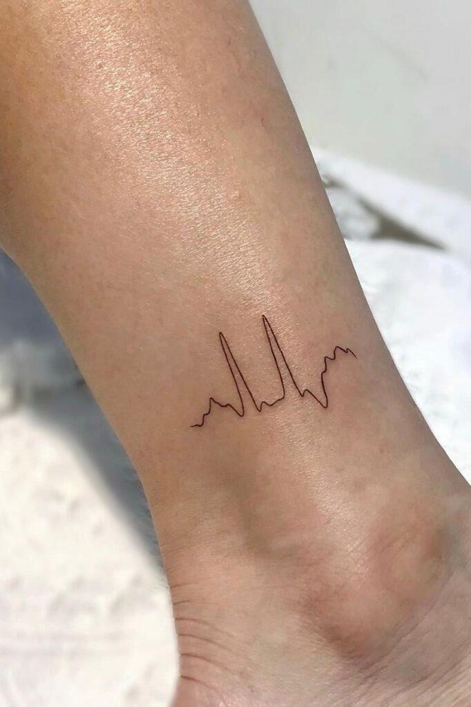 Heartbeat line tattoo