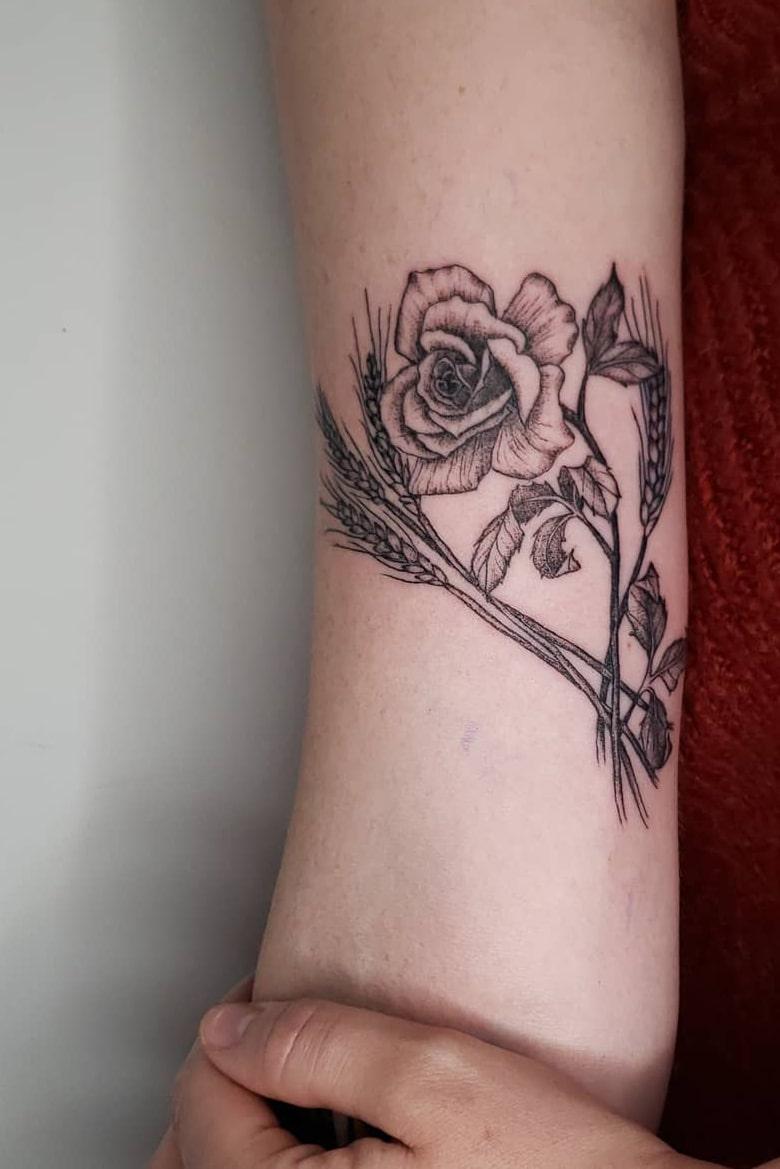 Elegant rose tattoo