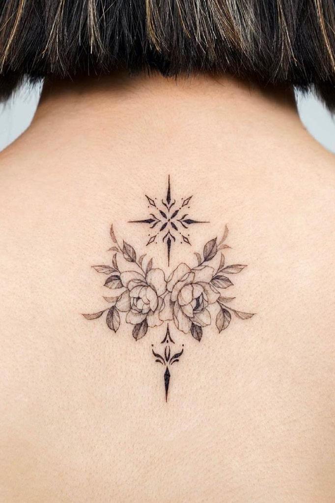 Geometric rose tattoo