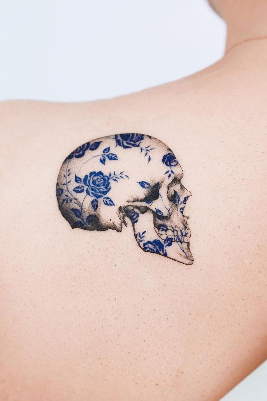 Skull blue rose tattoo