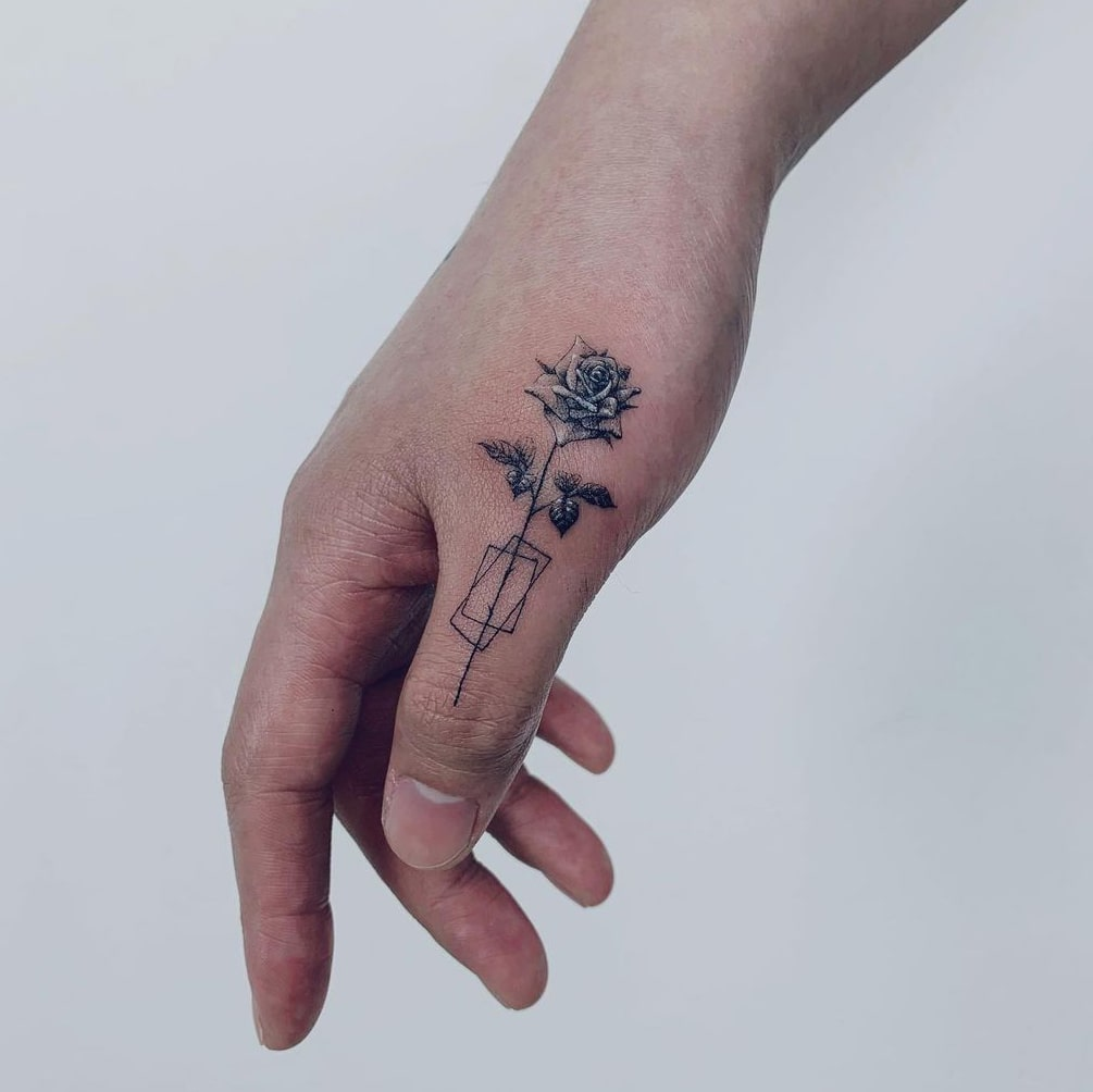 Rose tattoo on finger