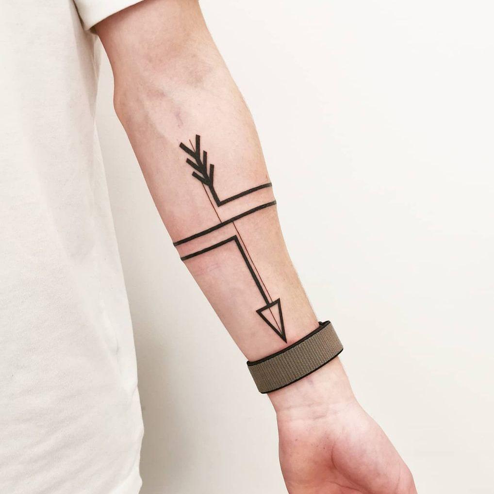 Modern minimalist arrow tattoo