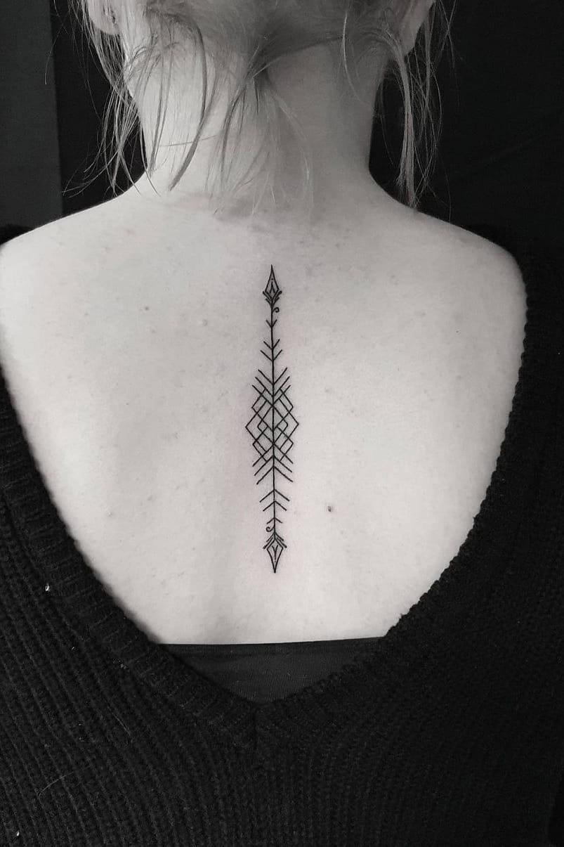 Arrow tattoo on the back