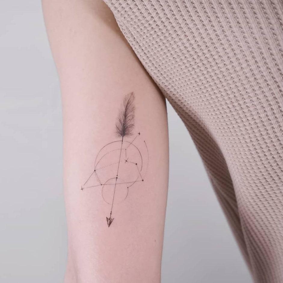 Zodiac arrow tattoo
