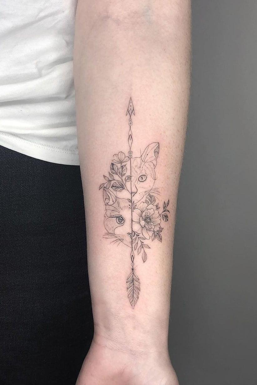 Cat arrow tattoo