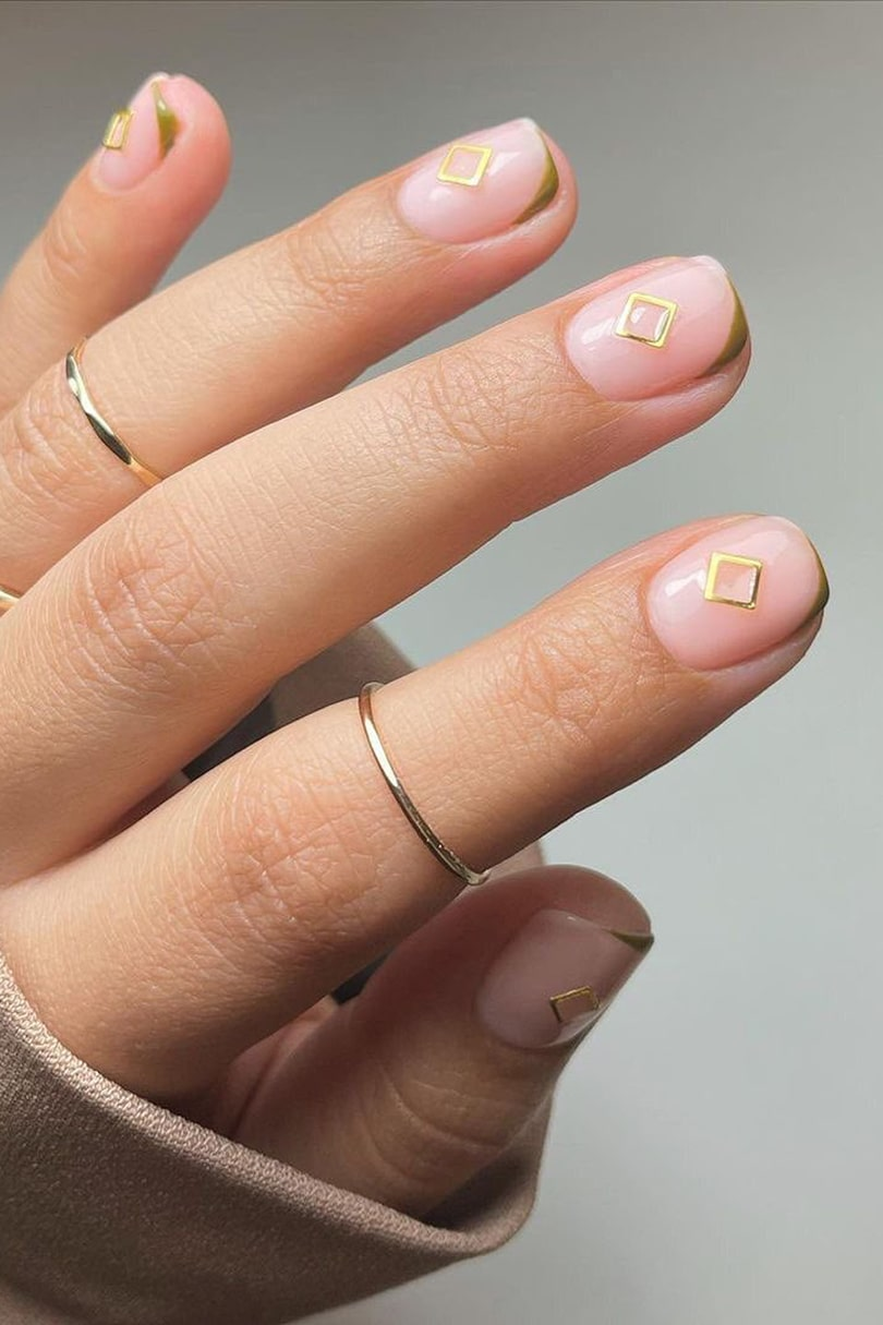 Gold hardware negative space nails