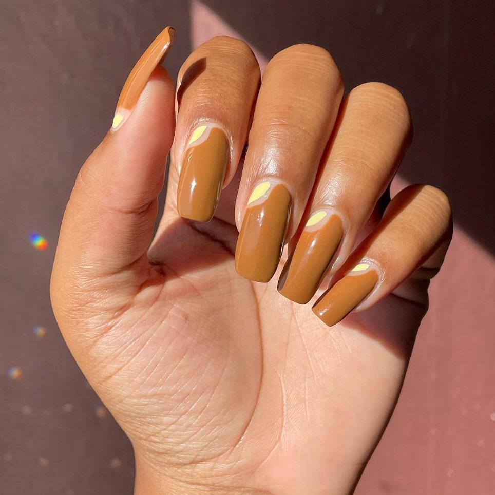 Warm brown negative space nails