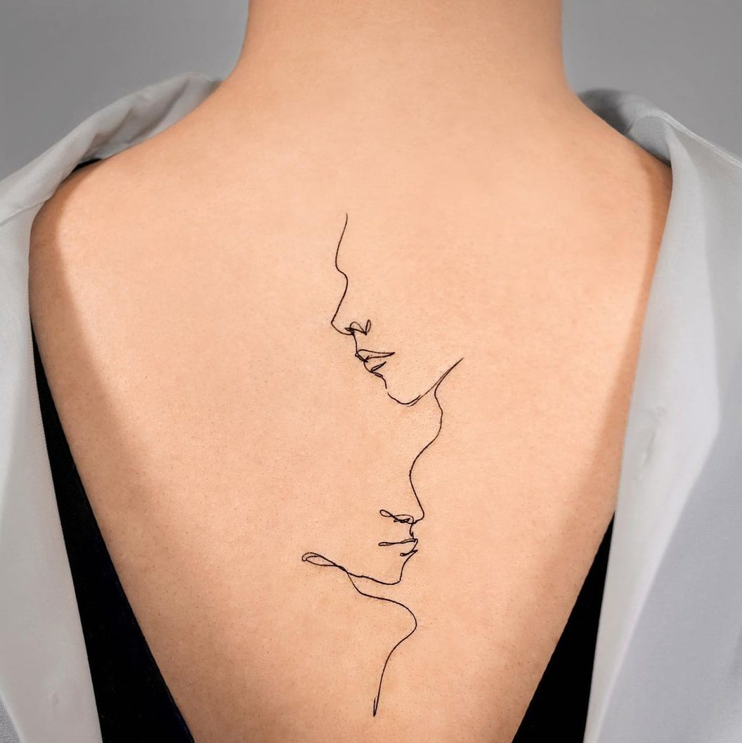 Line outline back tattoo