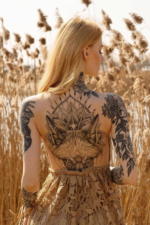 Gorgeous wolf back tattoo