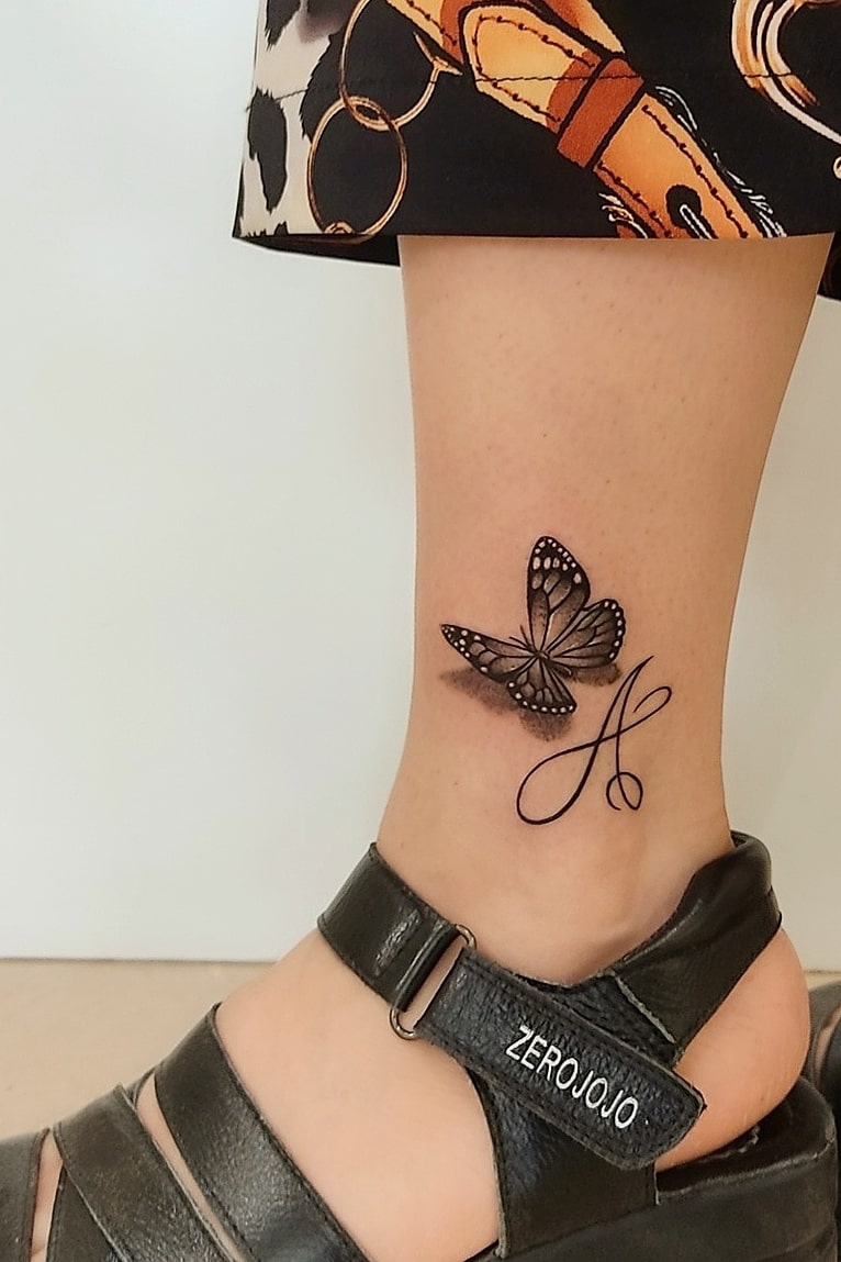 3D butterfly tattoo on ankle
