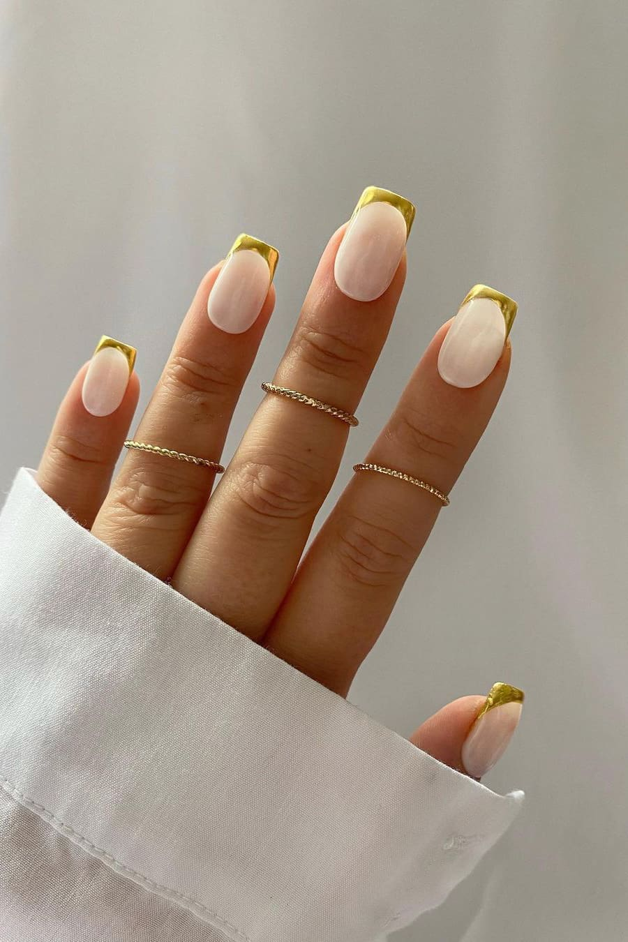 French chrome nails with golden tips