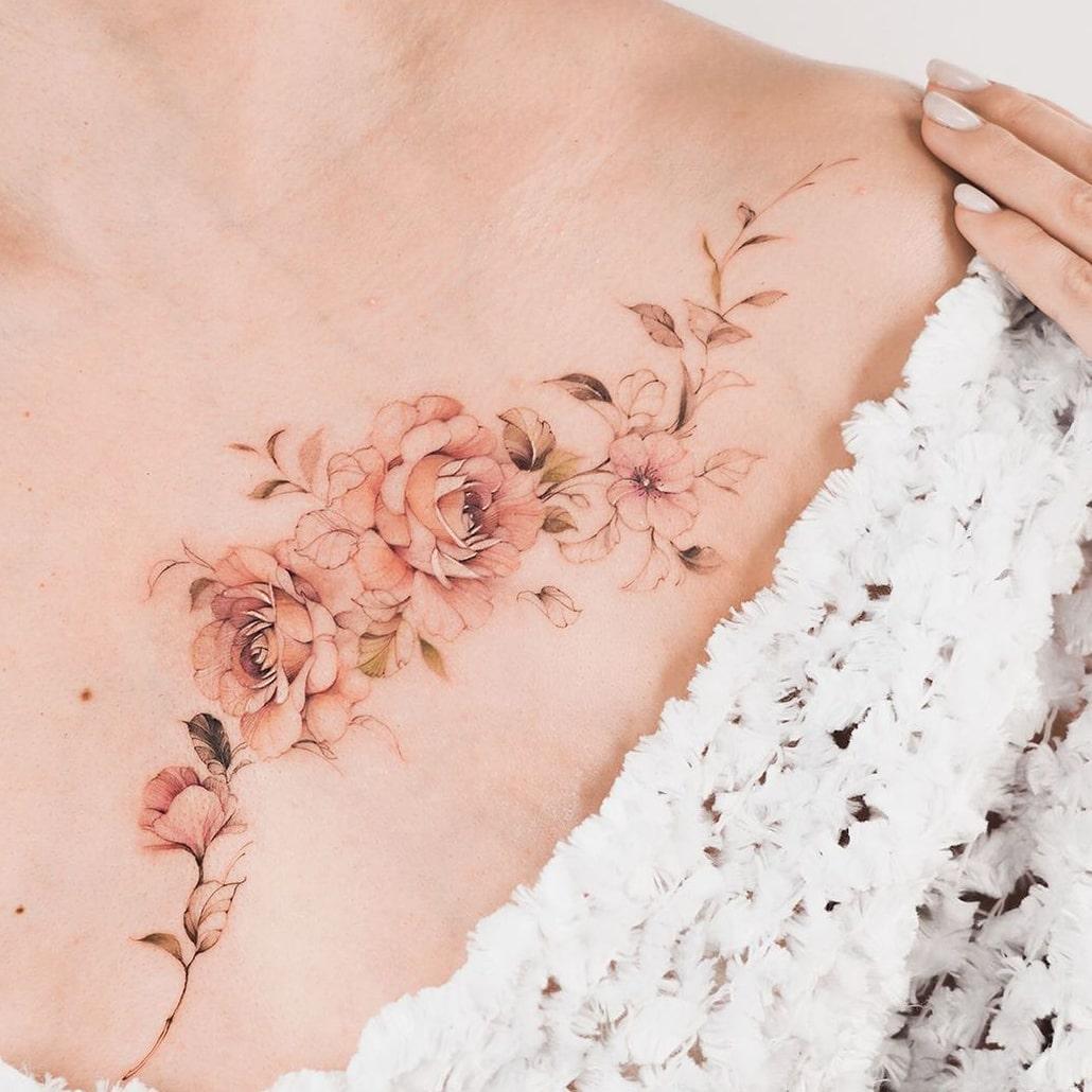 Flower collarbone tattoo