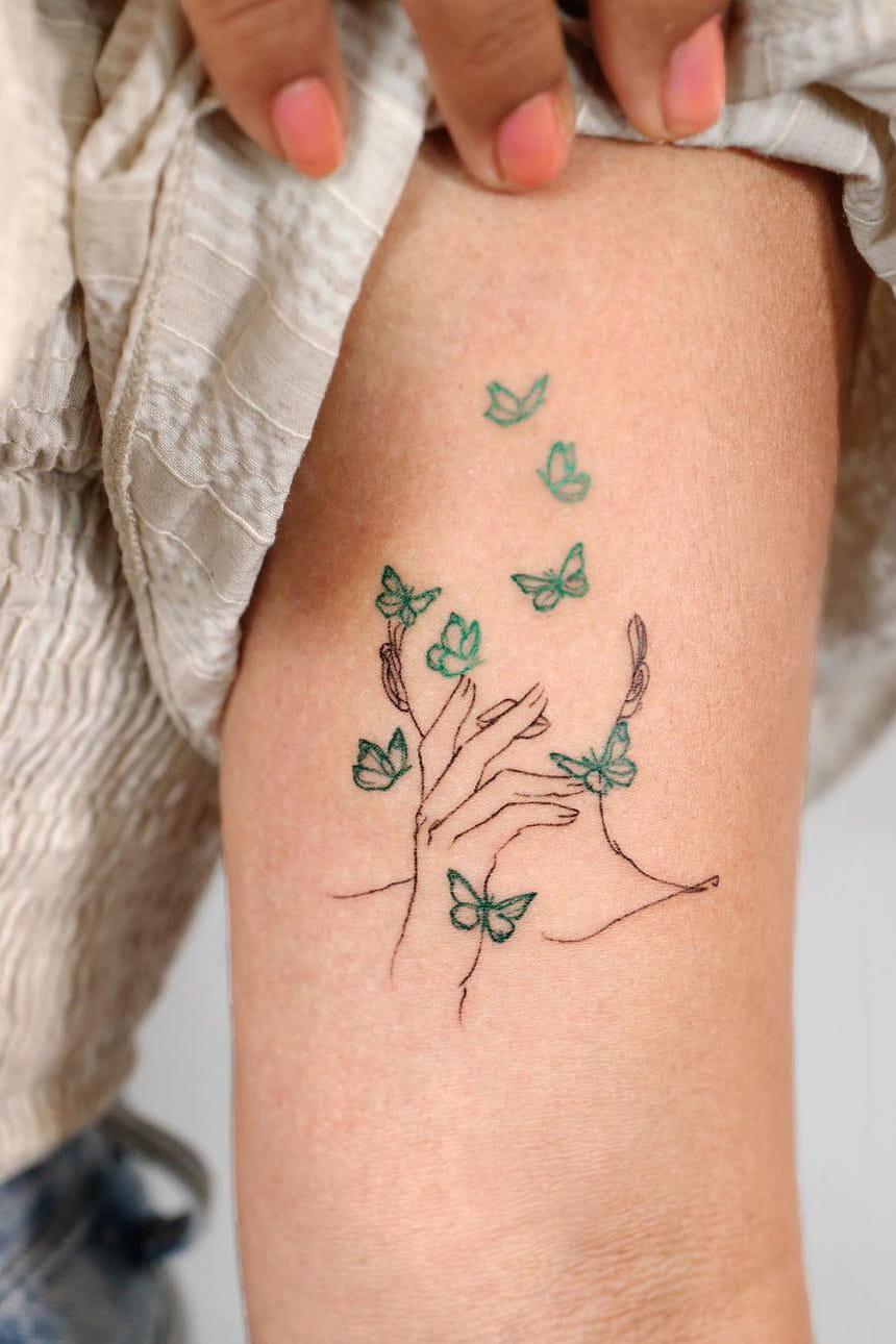 Minimalist small colorful tattoo