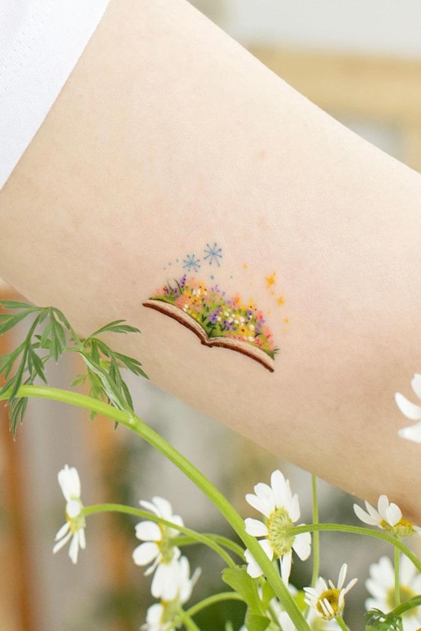 Book small colorful tattoo