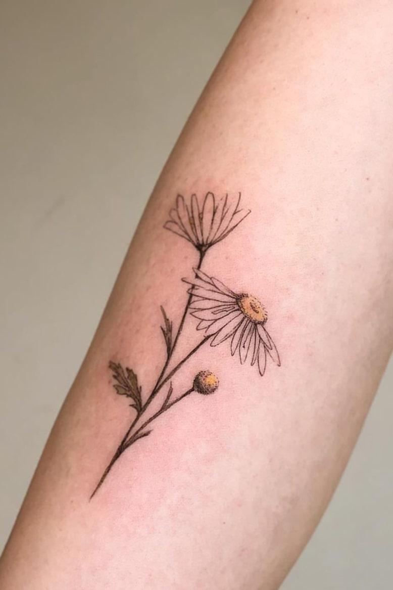 Daisy small colorful tattoo