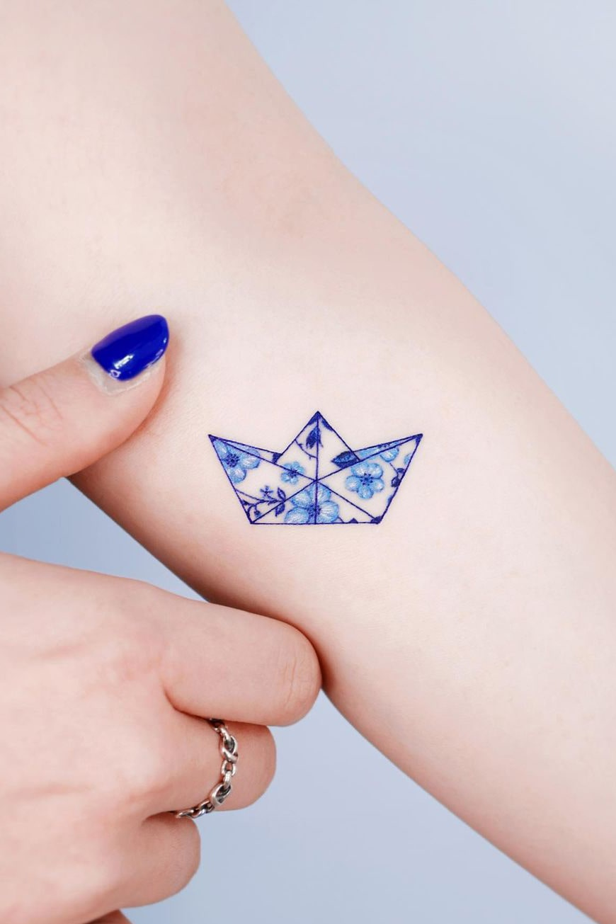 Exquisite paper boat small colorful tattoo