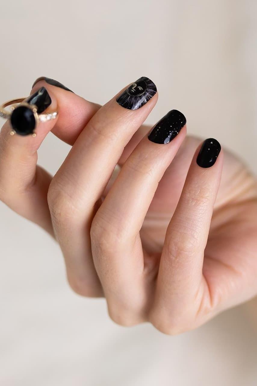 Black short galaxy nails