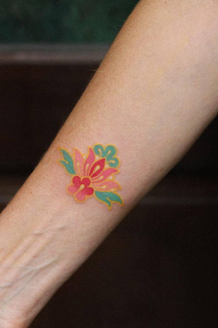 Colored lotus tattoo