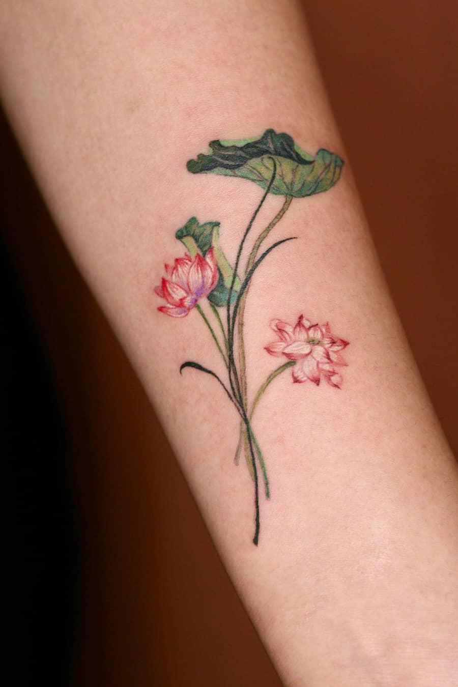 Green lotus tattoo