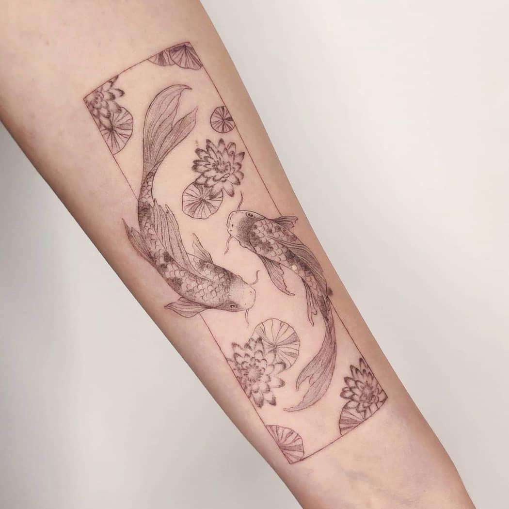 Koi fish lotus tattoo