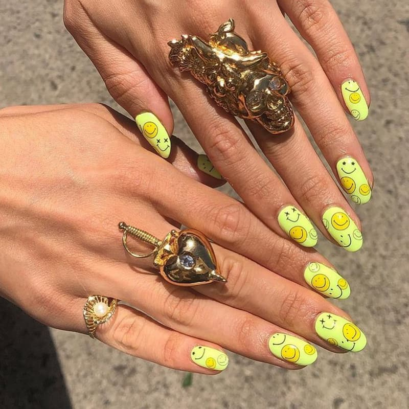 Light yellow oval smiley nails