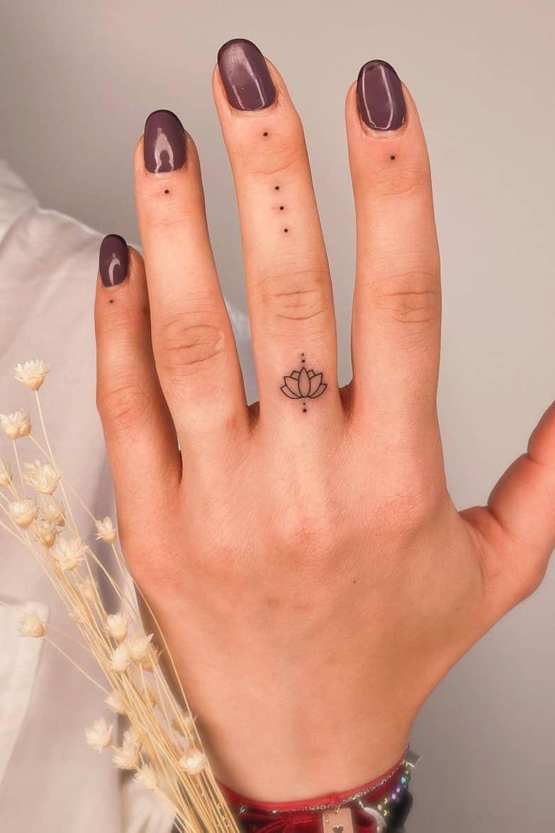 Lotus tattoo on finger