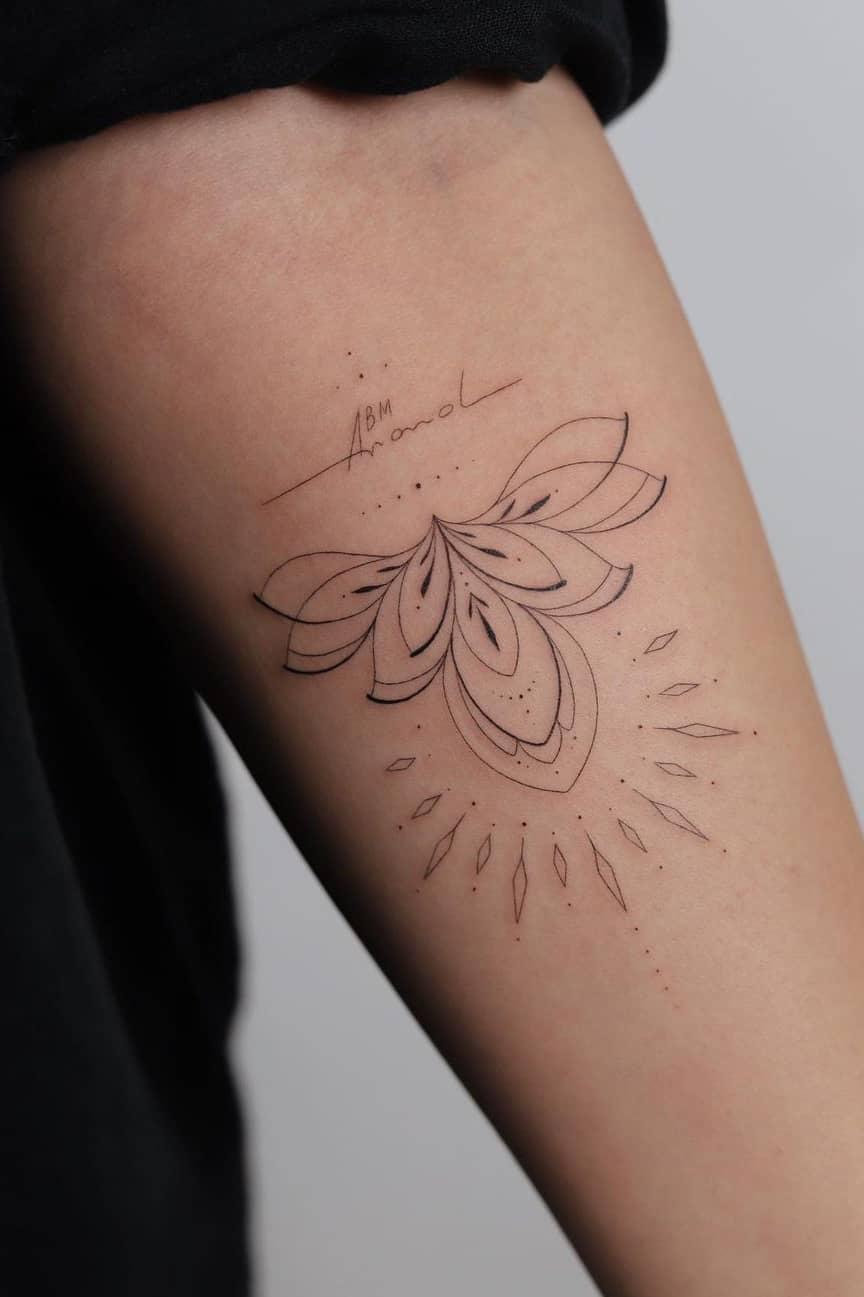 Lotus tattoo with name