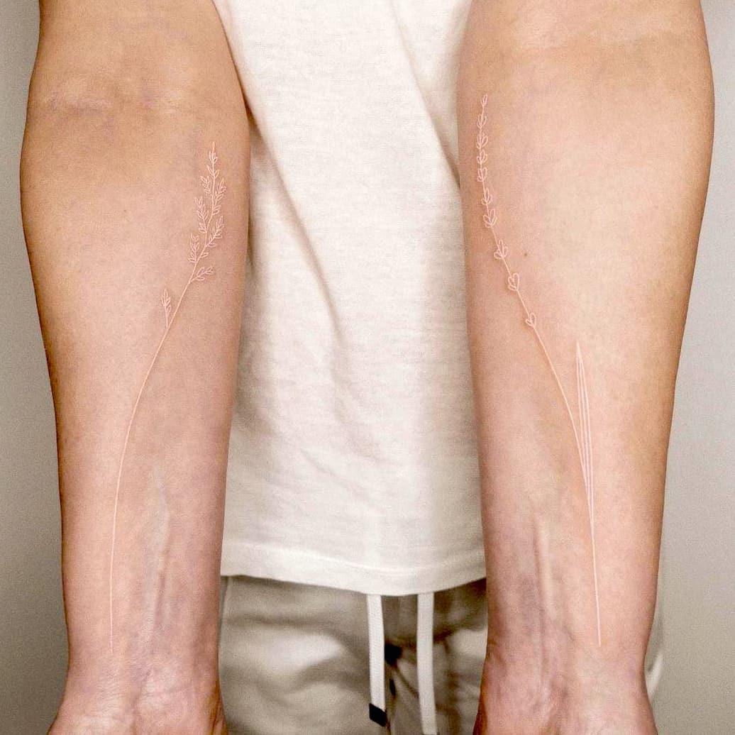 Minimalist white tattoo
